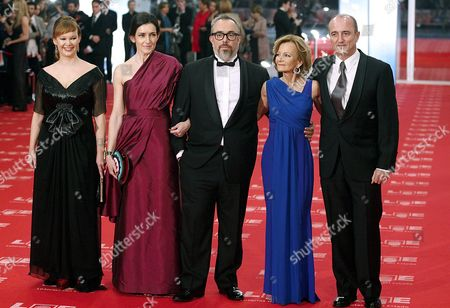 Stock Image of (l-r) Spain's Health Minister Leire Pajin Spain's Culture Minister Angeles Gonzalez-sinde Poses with Spain's Cinema Academy Director Alex De La Iglesia and Spain's Economy Minister Elena Salgado and Spain's Industry Minister Miguel Sebastian Upon Their Arrival to the 25th Edition of the Goya Cinema Awards Awarding Ceremony at Royal Theatre in Madrid Central Spain on 13 February 2010 Spain Madrid