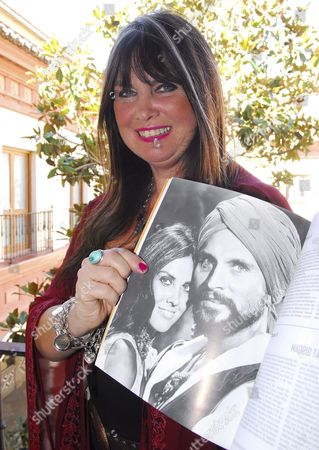 British Actress Caroline Munro Holds a Copy of the Book 'John Phillip Law Diabolic Angel' While Posing For the Media During the Classic Film Festival 'Retroback' in Granada Spain 30 January 2009 the Book is Based on Us Actor John Phillip's Life Spain Granada