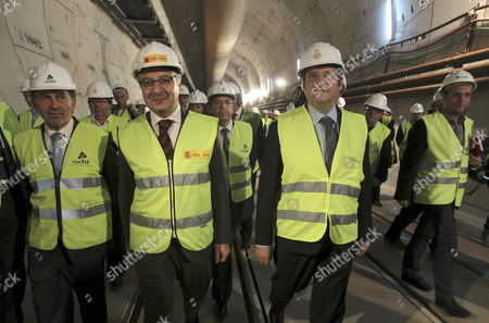 Spanish Minister For Public Works Jose Blanco (2-l Front) Barcelona's City Mayor Jordi Hereu (2-r Front) and the President of the Spanish Administrator of Railway Infrastructures (adif) Antoni Gonzalez (l) Visit a Tunnel Drilled by Tunnelling Machine 'Barcino' Close to the Sagrada Familia Cathedral in Barcelona North-eastern Spain 20 October 2010 the Tunnel is Part of Speed Train 'Ave' Railway Linking Madrid with Barcelona and with the French Border at the Section Sants-la Sagrera Spain Barcelona