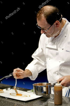 Stock Photo of Spanish Chef Hilario Arbelaitz Prepares a Plate During the 'San Sebastian Gastronomika' Congress in San Sebastian Spain 23 November 2009 Some of the Best Chefs of the World Are Attending the Event Running From 22 to 25 November at the Kursaal Congress Palace Spain San Sebasti?n
