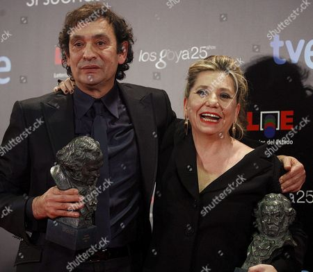 Spanish Director Agusti Villaronga (l) Poses with the Best Film Director Award and Producer Isona Passola (r) with the Best Film Award For Their Movie 'Pa Negre' During the 25th Annual Goya Awards Ceremony at the Royal Theatre in Madrid Spain 13 February 2011 Spain Madrid