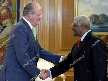 King Juan Carlos i of Spain (l) Shakes Hands with Mozambican President Armando Emilio Guebuza During the Reception Celebrated in Madrid Center Spain 18 De October 2010 Guebuza is in Spaion on a One-day Official Visit Spain Madrid