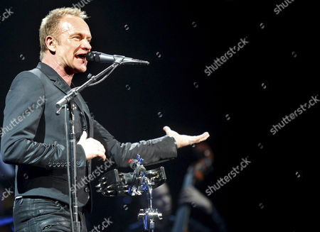 British Singer and Musician Sting Performs Live on Stage at Madrid's Sports Centre in Madrid Central Spain on 30 October 2010 As Part of His 'Symphonicity' Tour Along with Guitarist Dominic Miller and the Royal Philarmonic Concert Orchestra Spain Madrid