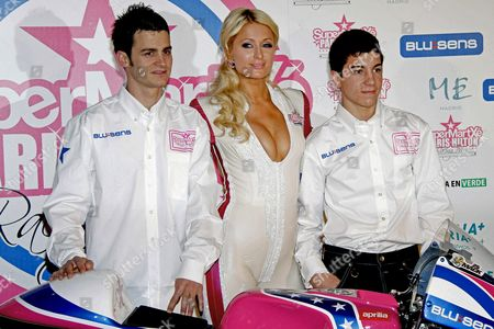 Us Personality Paris Hilton (c) Poses with Spanish 125 C C Pilots Sergio Gadea (l) and Maverick Vinales (r) During the Presentation of Her Motorcycle Racing Team 'Supermartxe Vip by Paris Hilton' in Downtown Madrid Central Spain 18 December 2010 the Team Will Compete in the 125cc Motogp World Championship 2011 Season Spain Madrid