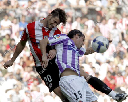 Athletic De Bilbao?s Defender Aitor Ocio (l) Jumps For the Ball Real Valladolid?s Damißn Escudero (r) During Their Spanish First Division Soccer Match at the San Mam?s Stadium in Bilbao on 21 September 2008 Spain Bilbao