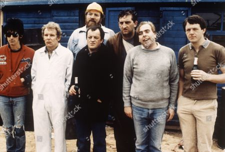 'Auf Wiedersehen Pet'  - Gary Holton, Christopher Fairbank, Pat Roach, Tim Healy, Jimmy Nail, Timothy Spall and Kevin Whately.