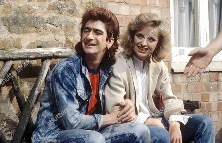 'Auf Wiedersehen Pet' - Gary Holton and Catherine Rabett.