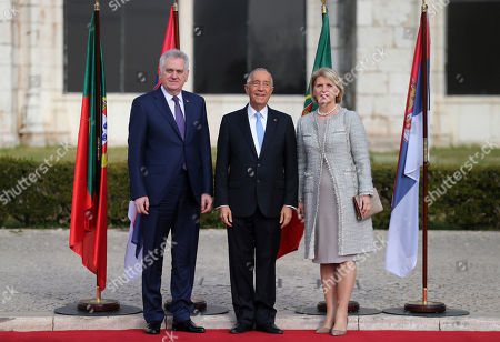 Tomislav Nikolic, Dragica Nikolic, Marcelo Rebelo de Sousa Serbia's President Tomislav Nikolic, left, and his wife Dragica Nikolic pose for the media with Portuguese President Marcelo Rebelo de Sousa during a welcome ceremony outside Lisbon's Jeronimos monastery on . Nikolic arrived in Lisbon on Wednesday for a two-day state visit to Portugal