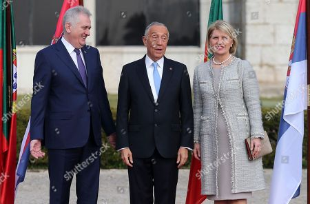 Stock Image of Tomislav Nikolic, Dragica Nikolic, Marcelo Rebelo de Sousa Serbia's President Tomislav Nikolic, left, and his wife Dragica Nikolic pose for the media with Portuguese President Marcelo Rebelo de Sousa during a welcome ceremony outside Lisbon's Jeronimos monastery on . Nikolic arrived in Lisbon on Wednesday for a two-day state visit to Portugal