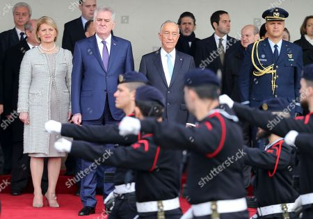 Tomislav Nikolic, Dragica Nikolic, Marcelo Rebelo de Sousa Serbia's President Tomislav Nikolic, center left, his wife Dragica Nikolic and Portuguese President Marcelo Rebelo de Sousa watch Portuguese Navy soldiers parade during a welcome ceremony outside Lisbon's Jeronimos monastery . Nikolic arrived in Lisbon Wednesday for a two-day state visit to Portugal