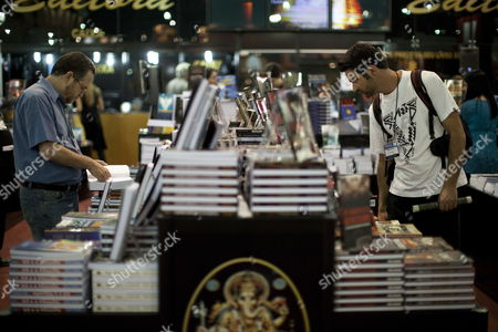 Visitors Observe Books at the International Book Biennale Held in Sao Paulo Brazil on 13 August 2010 the Biennale the Largest Publishing Event in the Country This Year Has the Presence of Iranian Writer Azar Nafisi and Norwegian Jostein Gaarder Brazil Sao Paulo
