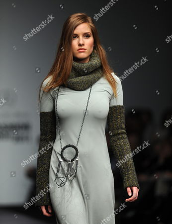 Stock Image of A Model Walks Down the Catwalk Wearing a Creation by Mexican Designer Elena Gomez Toussaint During the Second Day of the 2011 Mercedes Benz Dfashion Show Thath Takes Place in Mexico City Mexico on the 7 of March 2011 Mexico M?xico City