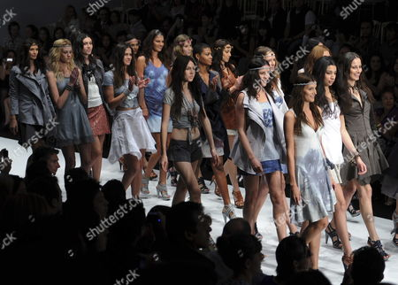 Stock Picture of A Group of Models Walk Down the Catwalk Wearing a Creations by Mexican Designer Elena Gomez Toussaint During the Dfashion Mercedes-benz Fashion Show of Spring-summer 2011 Collections Mexico City Mexico on 29 October 2010 Mexico Mexico City