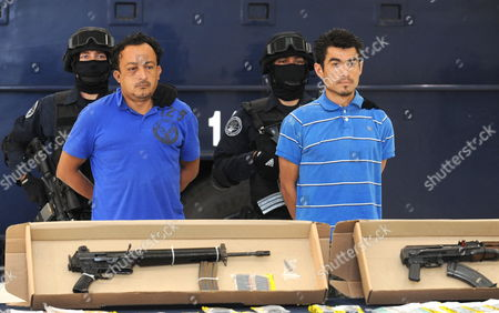 Stock Image of Federal Police Officers Exhibit Jesus Cardenas Perez Aka El Manos (l) and Cesar Arturo Galindo Aka El Guason (r) in Mexico City 02 May 2011 Perez and Galindo who Were Arrested on Sunday 01 May at the Municipality of Jiutepec in Morelos Are Accused of Being the Alleged Murderers of Juan Francisco Sicilia Son of the Mexican Writer Javier Sicilia who was Killed in Temixco Morelos Mexico Last 27 March Mexico Mexico City