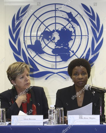 Executive Secretary of the Economic Commission For Latin America (ecla) Alicia Barcenas (l) and Un's Deputy Secretary-general Asha-rose Migiro (r) Talk During the Presentation of a Un Brief Called 'Metas Del Milenio Para Medio Ambiente' (millennium Goals For the Environment) where It Claims That Latin America Must Reduce is Deforestation Rates 'Which Doubles the World Average' and Must Cut Its Carbon Dioxide Emissions Which Has Increase 40 8% From 1990 to 2005 Mexico Mexico