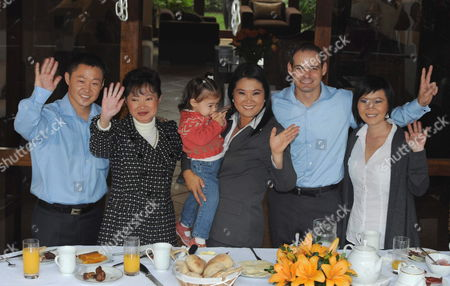 Peruvian Presidential Candidate Keiko Fujimori (c) Holds Her Daughter Kaori and Poses (l-r) with His Brother Kenji Fujimori Her Mother Susana Higuchi Her Husband Mark Villanella and Her Sister Sachi Fujimori at Her House in Lima Peru 05 June 2011 Final Opinion Polls Prior to the Election Showed a Technical Tie Between Left-wing Nationalist Ollanta Humala and Right-wing Keiko Fujimori Peru Lima