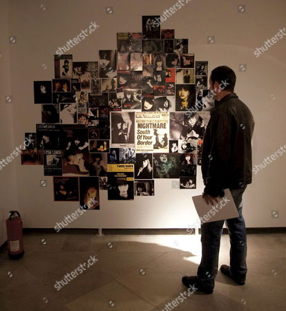 A Visitor Looks at a Collage Which is Part of the Exhibition 'Lydia Lunch Retrospectiva Paisajes Despu?s De La Batalla La Guerra Nunca Se Acaba' (lydia Lunch Retrospective Landscape After the Battle War is Never Over ) a Retrospective Exhibition Formed by Sixty Photographs Visual Montages Poem Fragments and a Sound Track by New York Singer Writer Actress and Photographer Lydia Lunch in Valladolid Spain 15 October 2010 the Exhibition Runs Until 21 November 2010 Spain Valladolid