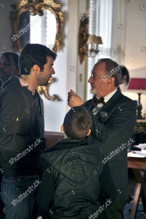 Stock Picture of (l-r) Spanish Director Christian Molina Young British Actor Fergus Riordan and Us Actor Robert Englund Are Work on the Set of Their New Movie 'De Mayor Quiero Ser Soldado' (when i Grow Up i Want to Be a Soldier) in Barcelona Spain 14 January 2010 Spain Barcelona
