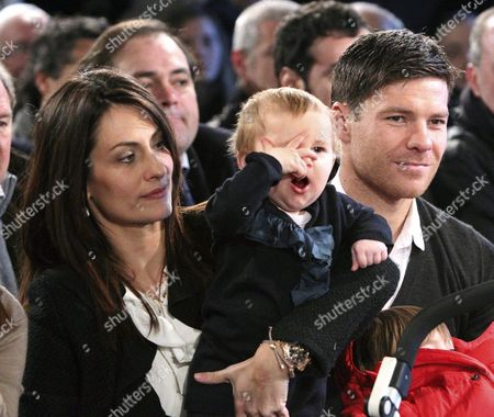 Spanish Real Madrid's International Soccer Player Xabi Alonso is Pictured with His Wife Nagore Aramburu and One of Their Children During the Tribute That His Home Town Tolosa Paid in His Honour 26 December 2010 in Tolosa in the Basque Country Northern Spain Spain Tolosa