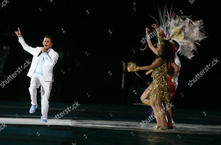 Colombian Singer Jorge Celedon (l) Performs the Official Song of the Event During the Inauguration of the Fifa Under 20 World Cup at Metropolitan Roberto Melendez Stadium in Barranquilla Colombia 29 July 2011 Colombia Barranquilla
