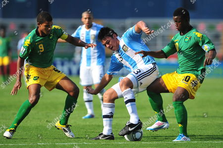 Argentina's Maximiliano Padilla (c) Fights For the Ball Against Jamaica's Omar Holness (l) and Jason Wright (r) During a Match of the Under 17 World Cup at Universitary Stadium in Monterrey Mexico 21 June 2011 Mexico Monterrey
