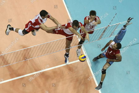 Polish Players Zbigniew Bartman (l) Krzysztof Ignaczak (2-l) and Michal Kubiak (3-l) in Action Against Jose Rivera (r) of Puerto Rico During the World Volleyball League Held at Roberto Clemente Coliseum in San Juan Puerto Rico During Group a Match on 11 June 2011 Poland Won Its Second Game by Defeating 3-0 (22-25 23-25 and 14-25) to Puerto Rico Puerto Rico San Juan