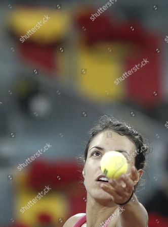 Spanish Tennis Player Nuria Llagostera Prepares to Shoot Against Russian Dinara Safina During Their Madrid Masters 1000 First Round Match Played at the Magic Box Arena in Madrid Spain 02 May 2011 Spain Madrid
