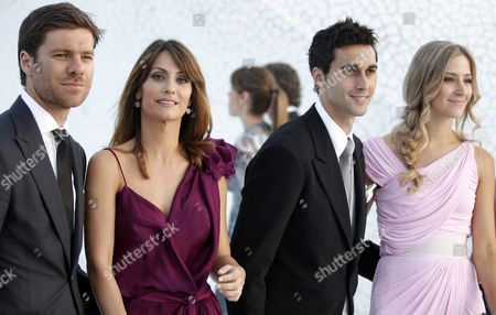 Real Madrid Players Xabi Alonso (l) and Alvaro Arbeloa (2nd R) Pose with Their Respective Wives Nagore Aramburu (2nd L) and Carlota Ruiz (r) Upon Their Arrival to the Wedding of Real Madrid and Spanish National Soccer Team Defender Raul Albiol and Alicia Roig (both not Pictured) at Valencia Cathedral in Valencia Eastern Spain 17 June 2011 After the Religious Ceremony the Wedding Party Left For Valencia's Palau De Les Arts Which Will Hold the First Wedding Reception After the Venue Has Been Fitted out For These Type of Celebrations Spain Valencia