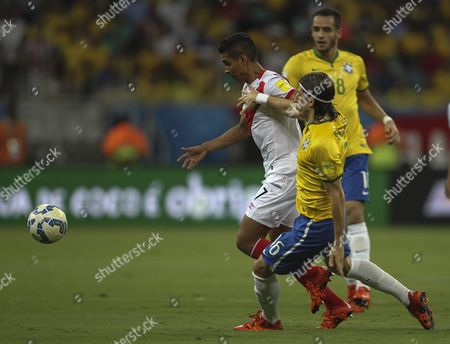 Brazilian National Soccer Team's Player Filipe Luis (r Front) in Action Against Peru's Paolo Hurtado (l) During Their South American Qualifying Round Match For World Cup Russia 2018 at Fonte Nova Stadium in Salvador Bahia Brazil 17 November 2015 Brazil Salvador