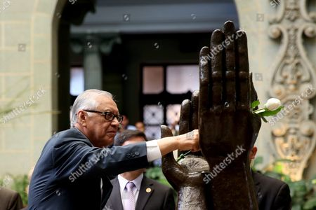 Guatemalan President Alejandro Maldonado Changes the 'Rose of the Peace' in the Monument to Peace at National Palace of Culture During the Commemoration of the 19th Anniversary of the Signing of Peace Agreements to End the 36 Years Internal Conflict in a Ceremony in Guatemala City Guatemala 29 December 2015 Guatemala Guatemala City