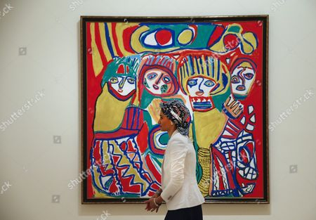 A Woman Walks Next to the Painting 'Mi Village Chatouka 1990' by Moroccan Painter Chaibia Talal That is Part of the Exhibition 'Looking at the World Around You: Contemporary Works From Qatar Museums' a Selection of 160 Artworks Modern and Contemporary Belonging to the Qatar Museums Which Hold One of the Most Significant Collections of Arab Art in the World Held at Santander Bank Foudation in Boadilla Del Monte Madrid Spain 08 February 2016 the Exhibition Which Runs From 09 February to 19 June Gather Works of Arab Artists Such As Etel Adnan Mona Hatoum Hassan Sharif Faraj Daham Shirin Neshat Wael Shawky Youssef Nabil Or Ghada Amer Spain Boadilla Del Monte