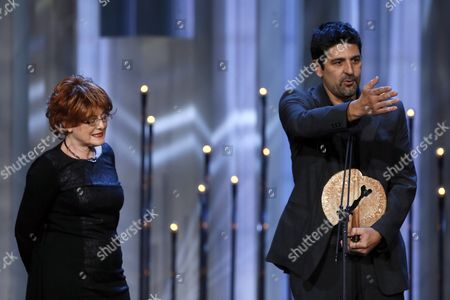 Producer Marta Esteban (l) and Director Cesc Gay (r) Stand on Stage After Receiving the 'Best Film' Award For 'Truman' During the 31st Jose Maria Forque Cinema Awards Held at the Congress Palace of Madrid in Madrid Spain 11 January 2016 Spain Madrid