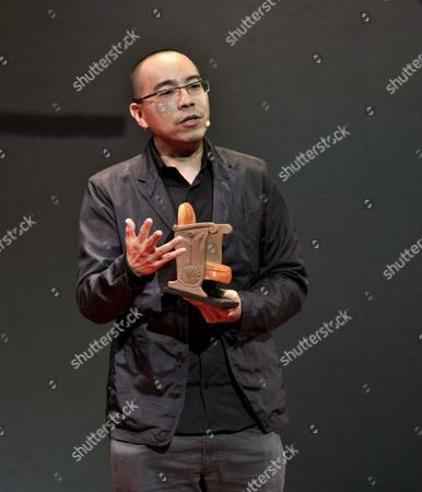 Thai Film Director Apichatpong Weerasethakul Talks to the Audience After Receiving a Gijon Film Festival Award During the Gijon International Film Festival Opening Gala Celebrates at Jovellanos Theatre in Gijon Northern Spain 20 November 2015 Spain Gij?n