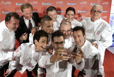 International Director of the Michelin Guides Michael Ellis (2-l) Poses For a Selfie with Spanish Three Star Michelin Guide Prize-winners Martin Berasategui (l); Joan Roca (c Back) of El Celler De Can Roca Restaurant; Elena Arzak (2-r Back) Jose Mari Arzak (r); David Munoz (3-l) of Diverxo; Pedro Subijana (c-r) of Akelarre); Carme Ruscalleda (l Front) of Sant Pau); Eneko Atxa (r) of Azurmendi and Quique Da Costa (c Front) During the Presentation of the Michelin Guide in Spain and Portugal 2016 in Santiago De Compostela Spain 25 November 2015 Spain Santiago De Compostela