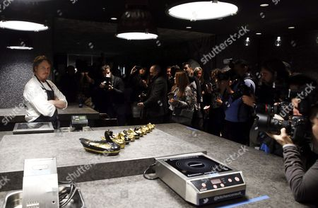 Stock Photo of Us Chef Grant Achatz (l) Poses For the Media During the Presentation of 'Alinea Madrid' a Temporary Replica of His Chicago Restaurant 'Alinea' at the Eurobuilding Hotel in Madrid Spain 11 January 2016 Alinea Madrid Will Opens Its Doors to the Public on 12 January Spain Madrid