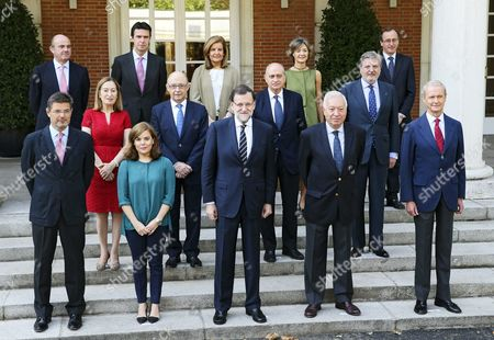 Spanish Prime Minister Mariano Rajoy (front C) Poses For a Group Picture with the 13 Members of His Cabinet at the Entrance His Official Residence in the Palace of La Moncloa Madrid Spain 03 July 2015 Rajoy Gathered His Ministers to Pose For His Government Term's Last Official Photo After He Named Inigo Mendez De Vigo on 25 June As His New Education Culture & Sport Minister in Substitution of Jose Ignacio Wert in the Photo Front Row L-r) Justice Minister Rafael Catala Vice Prime Minister Soraya Saeanz De Santamaria Prime Minister Mariano Rajoy Foreign Minister Jose Manuel Garcia Margallo Defence Minister Pedro Morenes; (middle Row L-r) Public Works Minister Ana Pastor Treasury Minister Cristobal Montoro Interior Minister Jorge Fernandez Diaz Education Culture and Sports Minister Inigo Mendez De Vigo; (back Row L-r) Economy Minister Luis De Guindos Industry Minister Jose Manuel Soria Labour Minister Fatima Banez Agriculture Minister Isabel Garcia Tejerina Health and Social Affairs Minister Alfonso Alonso Spain Madrid