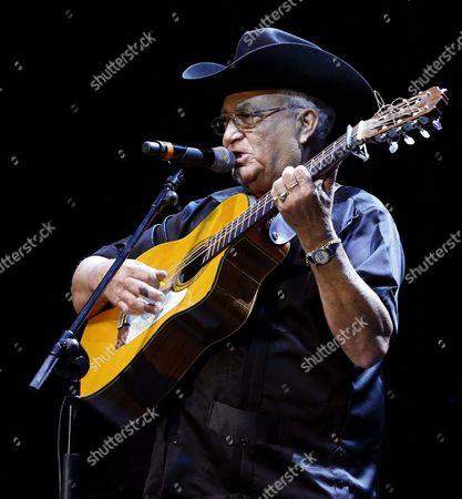Stock Image of Cuban Band 'Orquesta Buenavista Social Club' Guitarist and Singer Eliades Ochoa Performs on Stage During Their Adios Tour Concert Included in Village Summers Programme at Teatro Circo Price in Madrid Spain on 21 July 2015 Spain Madrid