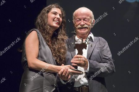 Italian Composer and Singer Gino Paoli (r) Receives From Spanish Singer Silvia Perez Cruz (l) the Mar De Musicas Award After His Performance at the Batel Auditorium in Cartagena Southeastern Spain 20 July 2015 Spain Cartagena