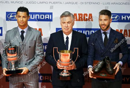 (l-r) Real Madrid's Portuguese Striker Cristiano Ronaldo Poses with the Pichichi Award For the Best Goal Scorer of the Spanish Primera Division Italian Soccer Coach Carlo Ancelotti with the Miguel Munoz Award For the Best Head Coach of the Primera Division and Real Madrid's Defender Sergio Ramos with the Luis Aragones' Award For the Best Spanish National Player During the Marca Sports Journal Award Ceremony in Madrid Spain 08 February 2016 Spain Madrid