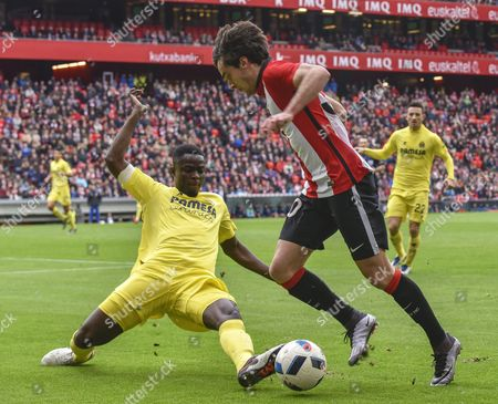 Athletic Bilbao's Inigo Lekue (r) in Action Against Villarreal's Defender Eric Bertrand Bailly (l) During the Spanish King's Cup Round of 16 Soccer Match Between Athletic Bilbao and Villarreal Cf in Bilbao Spain 06 January 2016 Bilbao Won 3-2 Spain Bilbao