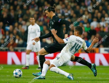 Real Madrid's Brazilian Midfielder Carlos Henrique Casimiro (r) Fights For the Ball with Swedish Striker Zlatan Ibrahimovic (l) of Paris Saint-germain During the Uefa Champions League Group a Soccer Match Between Real Madrid and Paris Saint-germain (psg) at Santiago Bernabeu Stadium in Madrid Spain 03 November 2015 Spain Madrid