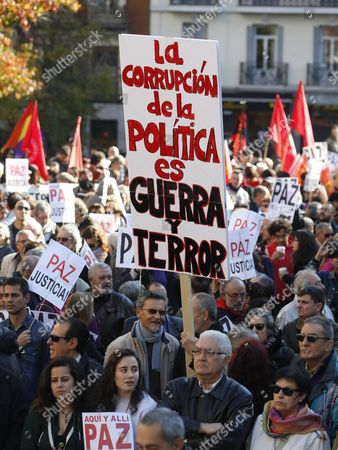 Protesters Hold a Banner That Reads 'Politic's Corruption is War and Fear' During a Gathering in Front of the Reina Sofia Museum in Madrid Spain on 28 November 2015 Called by the People Signing the Manifesto 'Not in Our Name' to Protest Against Military Intervention in Syria Politics Actors and Other Personalities Such As Madrid's Mayoress Manuela Carmena Barcelona's Mayoress Ada Colau Spanish Actress Pilar Bardem and the President of the 11-m Victim Association Pilar Manjon Have Signed the Manifesto 'Not in Our Name' to Protest Against Terrorism Wars and Islamophobia According to This Manifesto the Response to Paris Attacks Cannot Be with 'More Violence and Hate' Spain Madrid