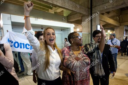 Daughter of South African Bishop Desmond Tutu Nontombi Naomi Tutu (2-r) Waves Next to the Wife of Venezuelan Opposition Leader Leopoldo Lopez Lilian Tintori (l) As She Arrives at the International Simon Bolivar Airport in Maiquetia Caracas Venezuela 17 February 2016 Nobel Peace Prize Winners Lech Walesa (poland) Oscar Arias (costa Rica) and Daughter of South African Bishop Desmond Tutu Mpho Tutu Arrives in the Latin American Country to Support Political Prisoners Venezuela Caracas