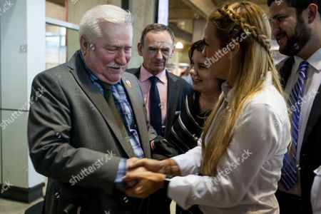 Former Polish President and Nobel Peace Winner Prize 1983 Lech Walesa (l) Greets the Wife of Venezuelan Opposition Leader Leopoldo Lopez Lilian Tintori (r) As He Arrives at the International Simon Bolivar Airport in Maiquetia Caracas Venezuela 17 February 2016 Nobel Peace Prize Winners Lech Walesa (poland) Oscar Arias (costa Rica) and Daughter of South African Bishop Desmond Tutu Mpho Tutu Arrives in the Latin American Country to Support Political Prisoners Venezuela Caracas