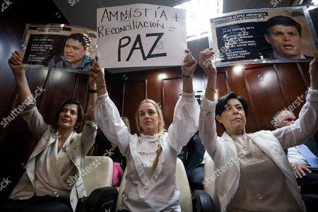 Lilian Tintori (c) Wife of Imprsioned Venezuelan Opposition Leader Leopoldo Lopez His Sister Maria Antonieta De Lopez (r) and Mother Diana Lopez (l) Hold a Banner at the National Assembly in Caracas Venezuela 04 February 2016 Tintori Expressed Her Support For an Amnesty Draft Bill Aimed to Release Political Prisoners Venezuela Caracas