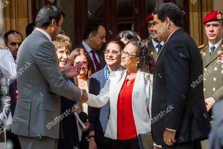 President of Venezuela Nicolas Maduro (r) and Rosa Virginia Chavez (2-r) Daughter of Late Venezuelan President Hugo Chavez Speak to the Emir of Qatar Sheikh Tamim Bin Hamad Al Thani (l) During Their Meeting in Caracas Venezuela 25 November 2015 Venezuela Caracas
