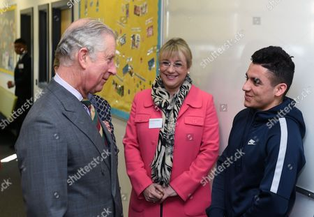 Prince Charles meets Dame Martina Milburn and Afghan refugee Baseer Omarkhil Khan, 16, (right) who studies motor mechanics, during a visit to The City of Leicester College in Evington, Leicester.