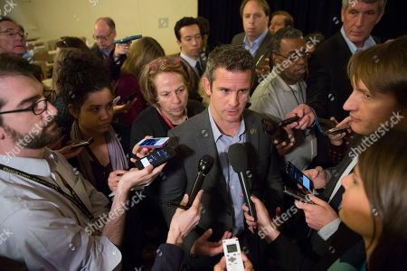 Rep. Adam Kinzinger, R-Ill., speaks with members of the media during a news conference at the Republican congressional retreat in Philadelphia