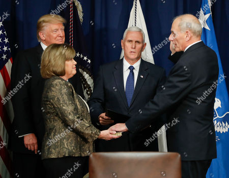 Donald Trump, John F. Kelly, Mike Pence, Karen Kelly President Donald Trump watches as Vice President Mike Pence, center, administers the ceremonial oath of office to Homeland Security Secretary John F. Kelly, right, as Kelly's wife Karen holds a bible, at the Homeland Security Department in Washington