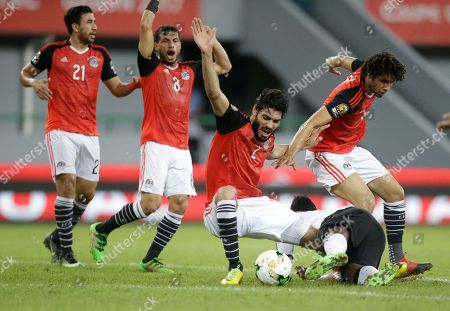 Egypt's soccer players react following a foul on Ahmed Ibrahim by Ghana's Asamoah Gyan, center, during their African Cup of Nations Group D soccer match at the Stade de Port-Gentil in Port-Gentil, Gabon